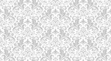 Fototapeta Room - Wallpaper in the style of Baroque. Seamless vector background. White and grey floral ornament. Graphic pattern for fabric, wallpaper, packaging. Ornate Damask flower ornament.