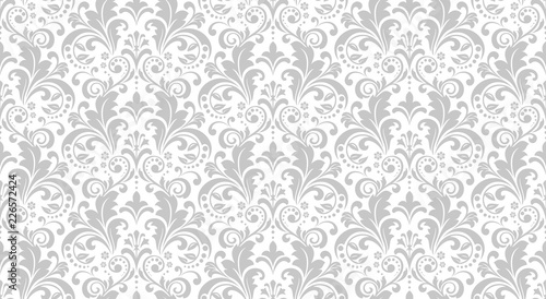 Wallpaper in the style of Baroque. Seamless vector background. White and grey floral ornament. Graphic pattern for fabric, wallpaper, packaging. Ornate Damask flower ornament. - 226572424