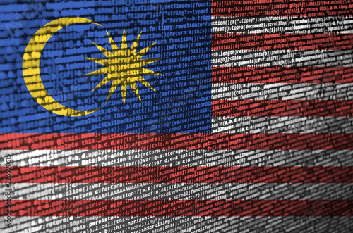 Malaysia flag is depicted on the screen with the program