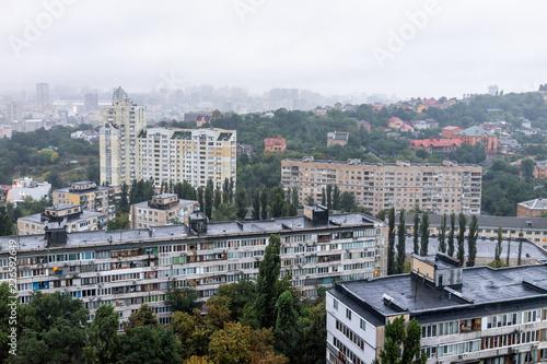 Fotobehang Kiev Kyiv, Ukraine cityscape skyline of Kiev by Vokzalna rail station metro area during gloomy, sad, dark, rainy, cloudy and overcast day, Soviet style apartment buildings, rain