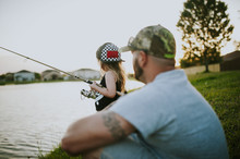 Side View Of Daughter Fishing ...