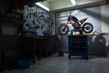 Motorcycle On Workbench In Aut...
