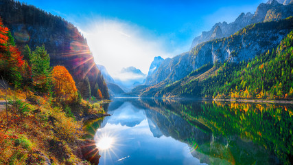 Fototapetaautumn scenery with Dachstein mountain summit reflecting in crystal clear Gosausee mountain lake