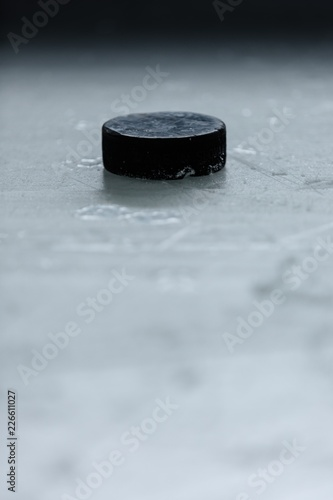 Photo  Hockey Puck on Ice Rink