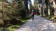 TS. Woman riding mountain bike on a gravel road