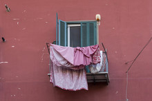 Pink Washing Drying On A Balco...