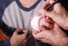 Young Baseball Fan Getting An Autograph