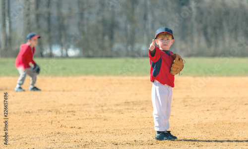 Young Baseball Player Giving a Thumbs Up