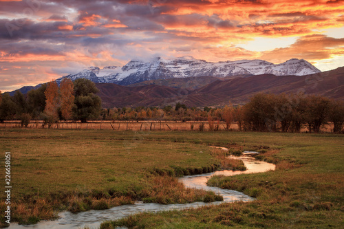 Papiers peints Corail Winding stream with snowy Wasatch Mountains, Utah, USA.
