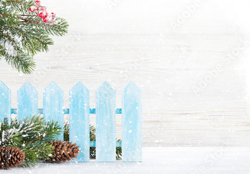 Papiers peints Akt Christmas fir tree branch covered by snow