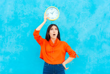 Woman Holding Clock Checking T...