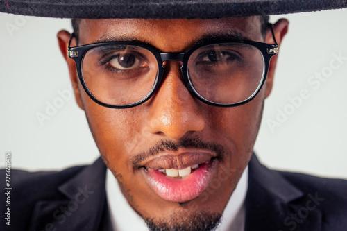 Fotografía  portrait african businessman american man in stylish suit wear glasses studio sh