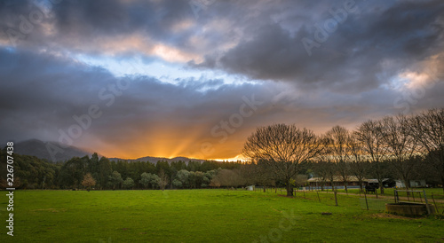 Australian countryside farming agriculture panoramic landscape with dramatic clouds at sunset