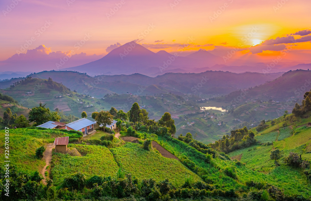 Fototapety, obrazy: Kisoro Uganda beautiful sunset over mountains and hills of pastures and farms in villages of Uganda. Amazing colorful sky and incredible landscape to travel and admire the beauty of nature in Africa