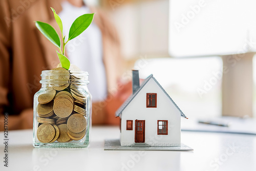 Fototapeta Saving money to invest in house or property in the future. Business Finance Concept. obraz