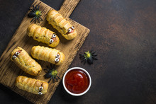 Halloween Food. Scary Sausage Mummies In Dough.