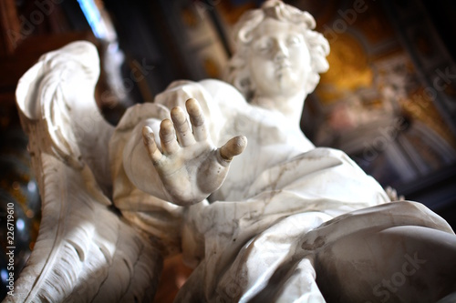 In de dag Historisch mon. Detail of the hand of an ancient statue of an angel; concept photo to express ideas like