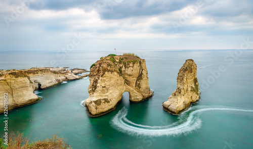 Fotografering Rouche rocks in Beirut, Lebanon near sea and during sunset