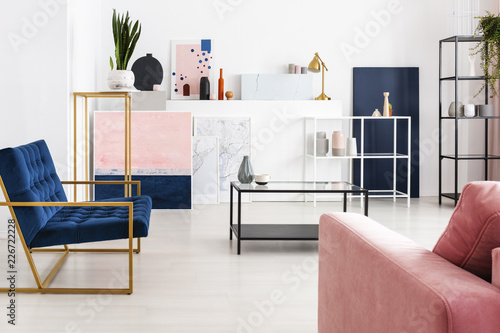 Metal Coffee Table With Glass Counter Top In The Middle Of Modern Full Of Color Living Room With Petrol Blue Armchair Powder Pink Sofa Shelf Maps And Paintings Real Photo Stock Photo