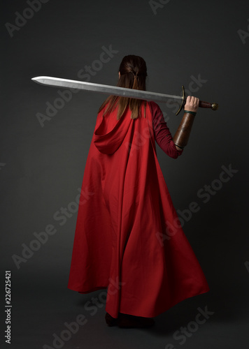 full length portrait of brunette girl wearing red medieval costume and cloak Canvas