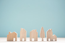Close Up Diffirance Wood House Model On Blue Background, Choose Home The Best For You, Planning To Buy Property.