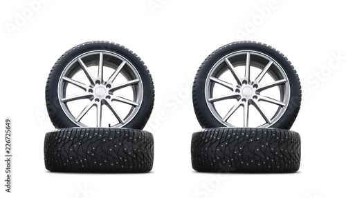 Fotografie, Obraz  Four new good-looking snow tires isolated on the white background