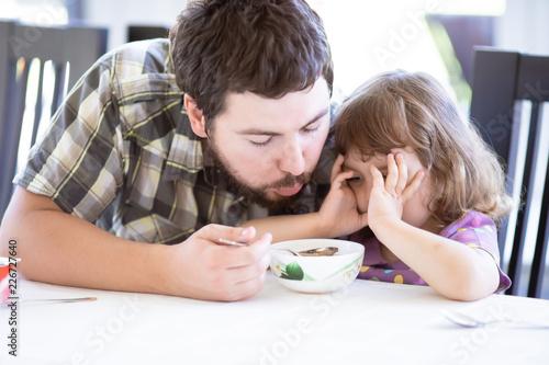 Fotografija  Cute little girl doesn't want to eat