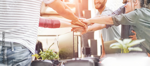 Fotografía  Young teamwork stacking hands together for new startup in creative office