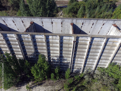 Staande foto Industrial geb. Quad-copter drone with camera explore abandoned industrial complex