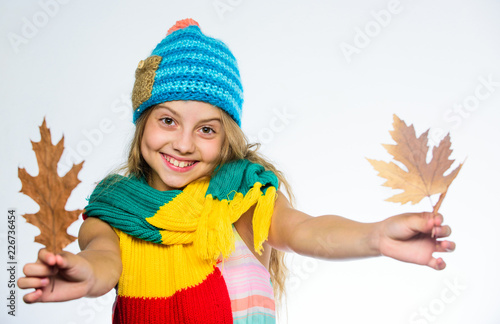 Valokuvatapetti Girl long hair happy face wear bright knitted hat and scarf white background
