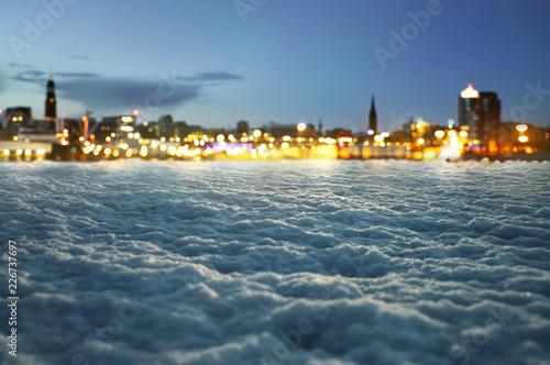 Photo  Winter Hintergrund mit unscharfen Stadtlichtern