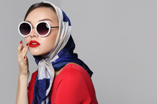 Young Woman In Retro Style. Sunglasses And Silk Scarf.