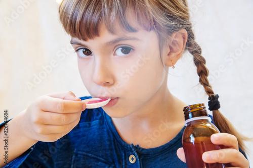 Valokuva  Sick child girl. Prescribe treatment. Selective focus.