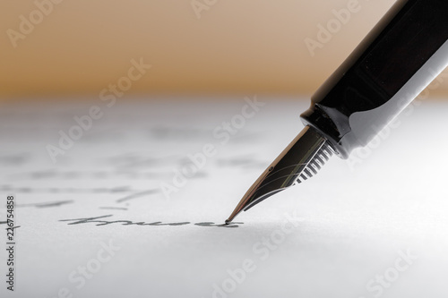 Photo  Fountain Pen on Written Page