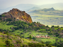 Ezulwini Valley In Swaziland With Beautiful Mountains, Trees And Rocks In Scenic Green Valley Between Mbabane And Manzini Cities. Traditional Huts Houses Of Swaziland