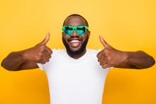 Portrait Of Cheerful Nice Glad Satisfied Mulato Man In Color Gre