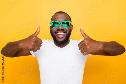 Photographie  Portrait of cheerful nice glad satisfied mulato man in color gre