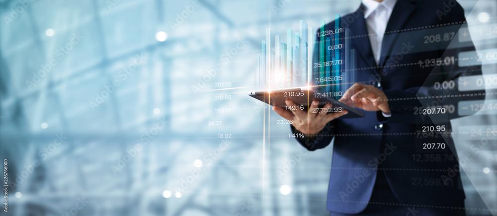 Fototapeta Businessman using tablet analyzing sales data and economic growth graph chart.  Business strategy.  Digital marketing.