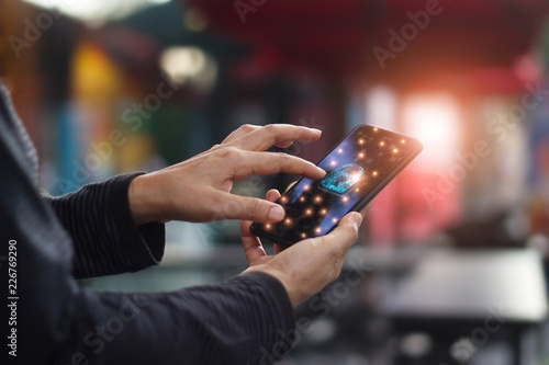 Human touching technology global networking security information safety and encryption with key padlock icon on virtual screen smartphone , Data protection and cyber security network concept