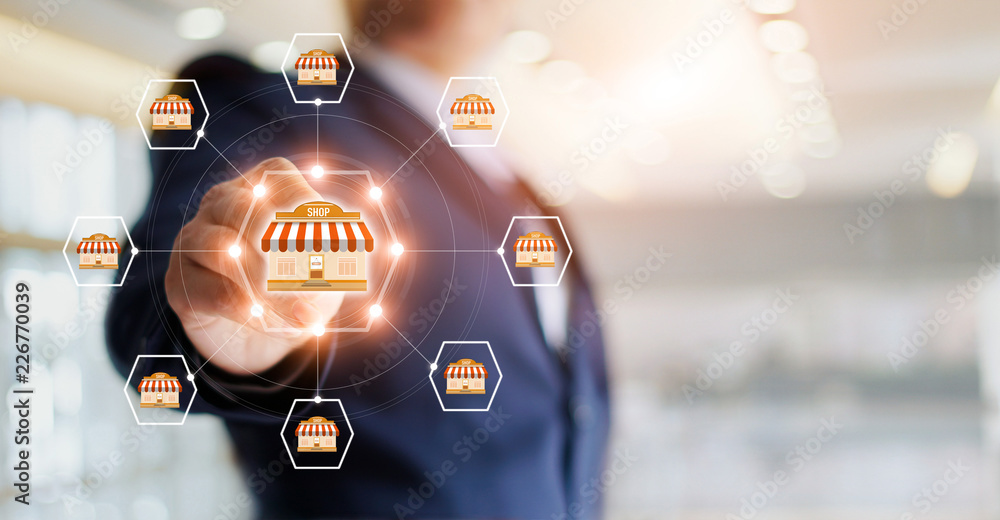 Fototapeta Businessman hand touching icon global network connection on franchise marketing system. Branch of market and customer. Modern technology business.