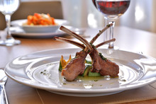 Rack Of Lamb On A White Plate