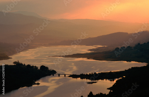 A map of Scotland appears at sunset on Loch Garry Canvas-taulu