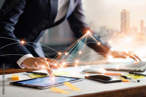 Businessman touching tablet and laptop Fototapete