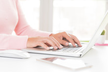 Closeup Female Hands Typing On Laptop Keyboard. Woman Working At Home Office Concept.