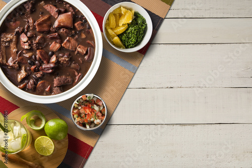 Fotografie, Obraz  Brazilian Feijoada Food. Top view with copy space.