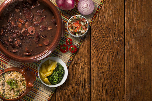 Foto Brazilian Feijoada Food. Top view with copy space.