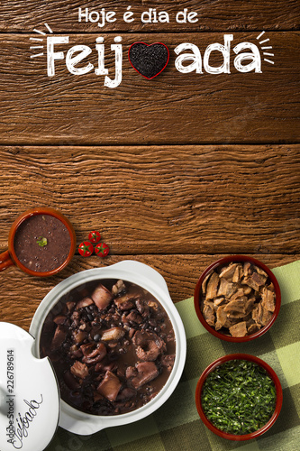 "Brazilian Feijoada Food. Written ""Today is Feijoada's Day"" in Portuguese. Top view with copy space."