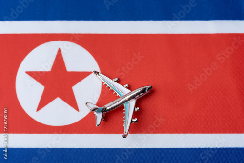 Fényképezés  Airplane over North Korea flag travel concept.