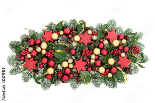 45c5e733ec47 ... pine cones and mistletoe isolated on white background. By marilyn  barbone. Christmas and winter table decoration with red and gold bauble  decorations, ...