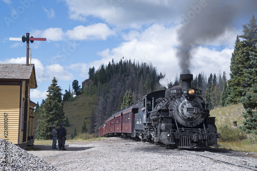 Cumbres Toltec historic narrow-gauge steam train engine stopped at Cumbre Pass on the way to Antonito, Colorado train station USA on September 9, 2018